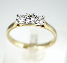 Three-Stone Yellow Gold SI2 Fine Diamond Rings
