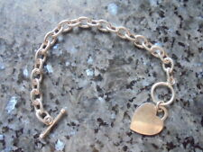 beau bracelet en  argent 925 avec petite breloque en forme de coeur