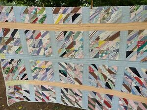 Vintage Strip Quilt with some feedsack material - Cutter Quilt