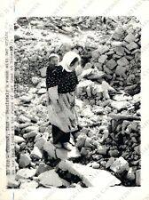 1962 IRAN Theran EARTHQUAKE DAMAGES Woman over destroyed house Photo