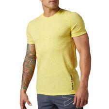 Abbigliamento e accessori giallo Reebok per palestra, fitness, corsa e yoga