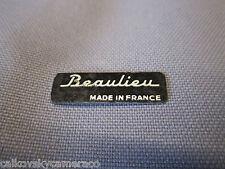 'BEAULIEU LOGO BADGE' for Beaulieu 16mm movie camera.