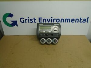 2004 > HONDA JAZZ STEREO CD PLAYER AND HEATER CONTROLS WITH AC
