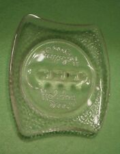 Vintage HOLIDAY INN advertising clear GLASS ashtray with logo & pebble designs.