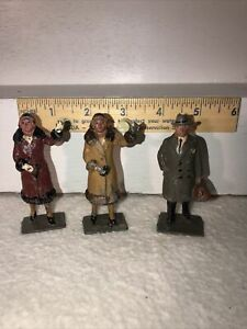 3 VINTAGE LEAD FIGURES, WOMAN IN BROWN COAT, MAN  BRIEF CASE LIKE BARCLAY MANOIL