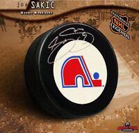 JOE SAKIC Signed Quebec Nordiques Puck - Colorado Avalanche