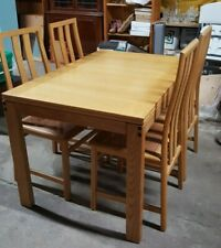 Good solid wood, hinged/rotating, extendable dining room table and four chairs