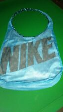 Nike shoulder bag color blue with black Nike writing for women