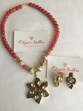 Gold Toned Orange Colour Imitation Pearl And Kundan Work Necklace With Earrings