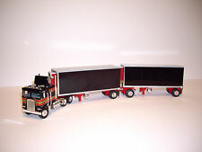 DCP 1/64 BLACK WITH RED AND GOLD STRIPE KW K100 WITH WABASH DOUBLE REEFER PUPS
