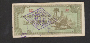 1/2 RUPEE VF BANKNOTE FROM JAPANESE OCCUPIED BURMA 1942  WITH UTILITY STAMPS