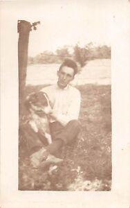 D81/ Dog Pet Animal RPPC Postcard c1920 Man With Dog Fence Farm 19