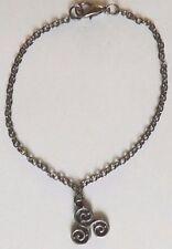 bracelet noir 19,5 cm spirale triple ou triskel (symbole celtique) 16x13mm