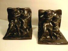 older cast metal bookends of 2 small nude children or cherubs
