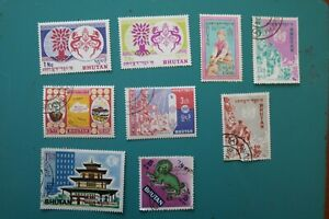 Bhutan small collection 9 items hinged OG or cancelled WYSIWYG cat $12 US