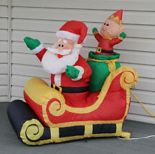 Gemmy  Airblown Yard Inflatable Santa Waving in Sleigh With Elf