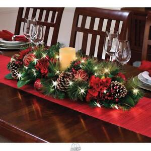 The Cordless Prelit LED Centerpiece Flameless Candle Poinsettia Christmas