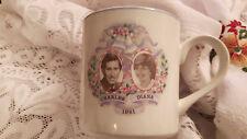 2 beakers mugs  Charles and Diana wedding