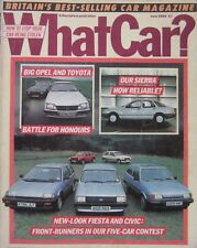 What Car? 06/1984 featuring Toyota, Opel, Alfa Romeo, Ford, Austin, Vauxhall