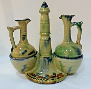 KA113 MEXICO POTTERY CRUET SET (2 cruets and stand), artist signed