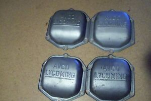 "Four Lycoming Rocker Box Covers with Large ""AVCO LYCOMING"" Lettering."