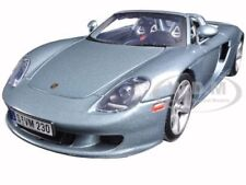 Porsche Carrera Gt Silver With Black Interior 1/18 Diecast Model Motormax 73163