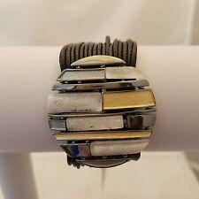 Gray/gold/white mosaic design medallion on multi-strand black leather bracelet