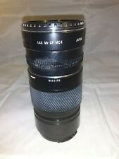 Minolta AF 135 lens with Tamron-F tele converter 1.4x mc4 with case