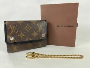 Authentic Monogram Macassar Trifold compact wallet with chain.