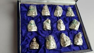 Set of 12 silver plated collectible figurines