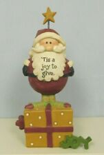 Santa standing on top of a gift box that has Joy - New by Blossom Bucket #86378