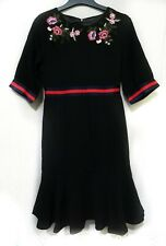 Black Fishtail Dress With Red And Blue Trim & floral patch
