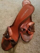 Nine West, brand new w/out box orange/brown w/bow slip on heels