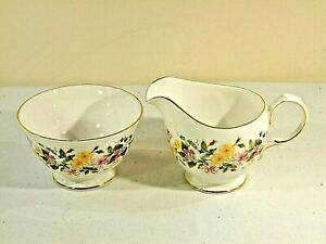 A VINTAGE MILK JUG AND SUGAR BOWL BY COLCLOUGH IN A FLORAL PATTERN
