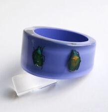 Unique lilac lucite bracelet with real metallic beetles