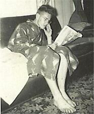 VINTAGE PHOTO: YOUNG MAN w GLASSES LONG LEGS & BIG FEET ROBE READING PAPER ID'd