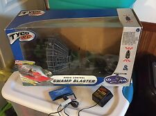 Up for Auction Is A Tyco R/C Swamp Blaster 9.6V 49mAh With Original Box & Manual