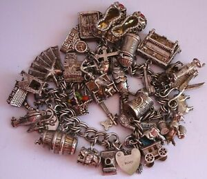 Stunning vintage solid silver charm bracelet & 35 charms,rare,open,move. 108.7g