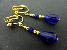 A PAIR OF COBALT BLUE CRYSTAL  GOLD PLATED CLIP ON TEARDROP  EARRINGS.