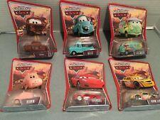 Disney Pixar Cars 6 Cars NEW FREE SH HAMM-FERRARI-MATER-FILLMORE-RPM 64-FRED