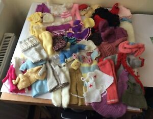 lots of vintage knitted dolls clothes  - ruler in photos