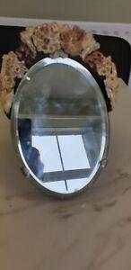 vintage oval plaster flower decorated mirror