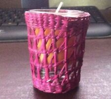 ORANGE CANDLE IN RED WICKER HOLDER