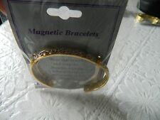 BNWT Gold tone Magnetic bracelet / bangle -  silver swirl pattern
