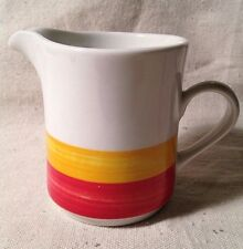 Oneida stoneware Rainbow Bright Creamer with red and gold stripes on white