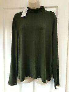 A great Warehouse Ladies Green Roll Neck Top, size 18