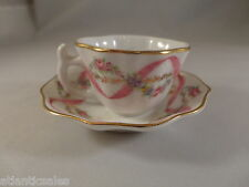Miniature porcelain cups and saucers with floral design  two sets Collectible