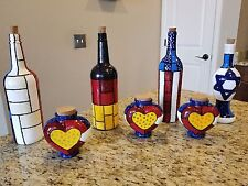 hand painted flags in wine bottles