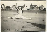 1910s French Woman Doing Gymnastic Split on the Beach Photo