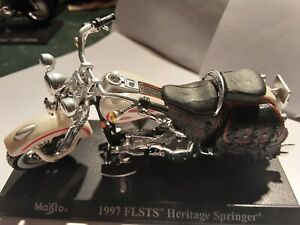 Miniature moto Maisto ech 1/43 Harley davidson 1997 FLSTS Heritage Springer